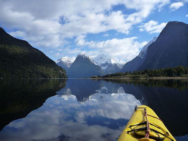 An Active New Zealand adventurer kayaking Milford Sound, NZ